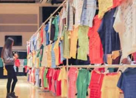 Shirts with anti-sexual assault messages hung on clothesline