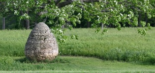 Goldsworthy Cairn in summer field