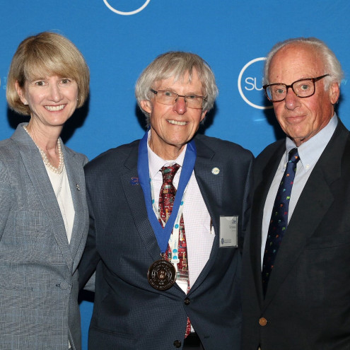 SUNY Chancellor Kristina M. Johnson, Professor Joseph Skrivanek, and President Thomas J. Schwarz at Distinguished Faculty Ceremony Induction, May 18, 2018