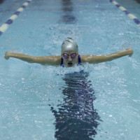 Swimmer in the pool in Physical Education building