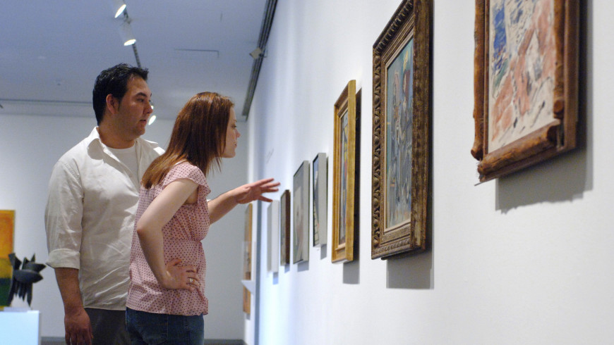 People in museum looking at art