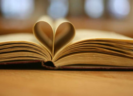 Book image with pages folded inward to form a heart