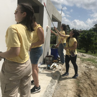 student performing service in Puerto Rico