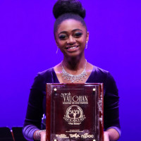 Samara Joy McLendon '21 holds her Sarah Vaughan Jazz Vocal award.