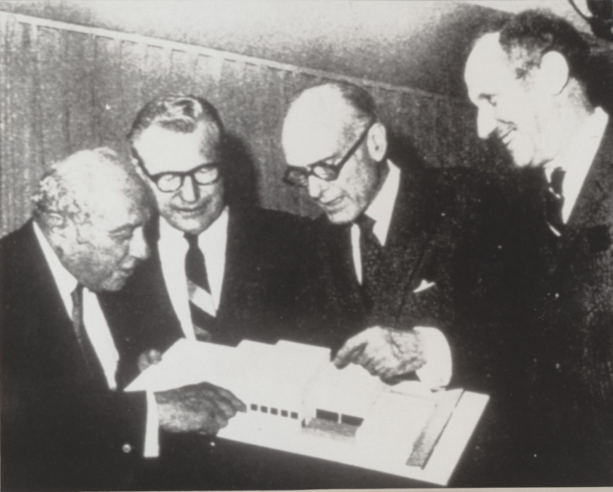 "This picture shows August Heckscher, then New York City Parks Commissioner, examining the model at the opening of the exhibition ""Architecture for the Arts: The State University of New York College at Purchase,"" held in the Philip L. Goodwin Galleries for Architecture and Design of Modern Art, May 1971."