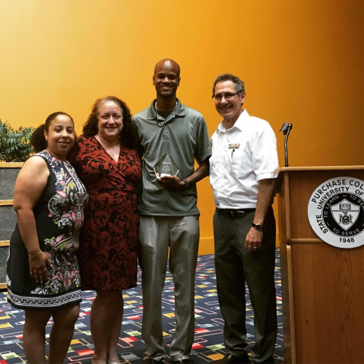 Donnell Charles, second from right, pictured with EOP director, Paul Nicholson (R), EOP Counselors, Mary Garcia, and Glory...