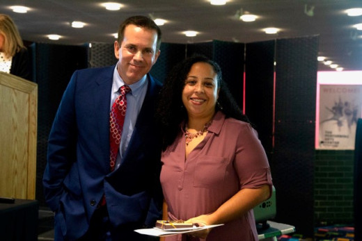 Glory Rojas pictured with Dennis Craig, VP of Student Affairs/Enrollment Management at Faculty/Staff Recognition Lunc...