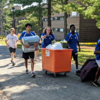 members of the Purchase men's soccer team assist with move in 2019