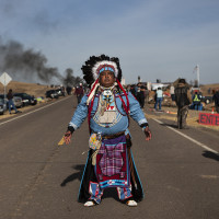 Highway 1806: Dan Nanamkin of the Yakima Nation of Washington state stands on Highway 1806, part ...