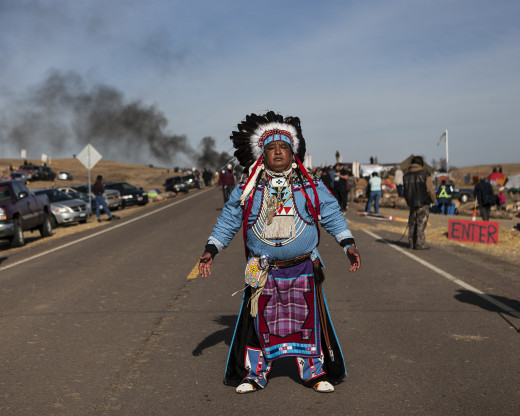 Highway 1806: Dan Nanamkin of the Yakima Nation of Washington state stands on Highway 1806, part of the historic Lewis