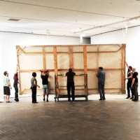 Museum staff moving one of the 28 Threnody panels into the gallery