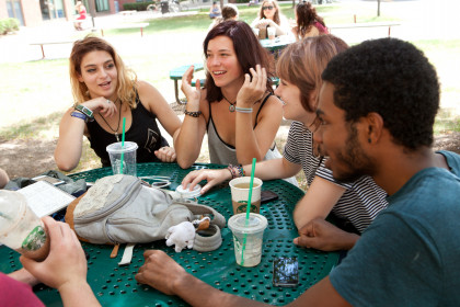Students talking at an outdoor table