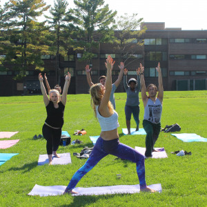 Students doing yoga on the Great Lawn