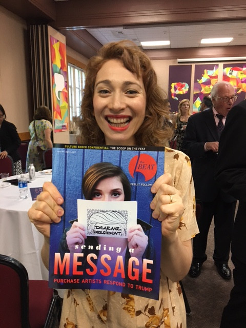 Regina Spektor '01 holds a copy of The Purchase Beat