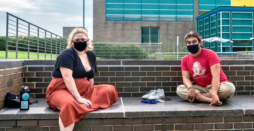 Students on campus wearing masks.