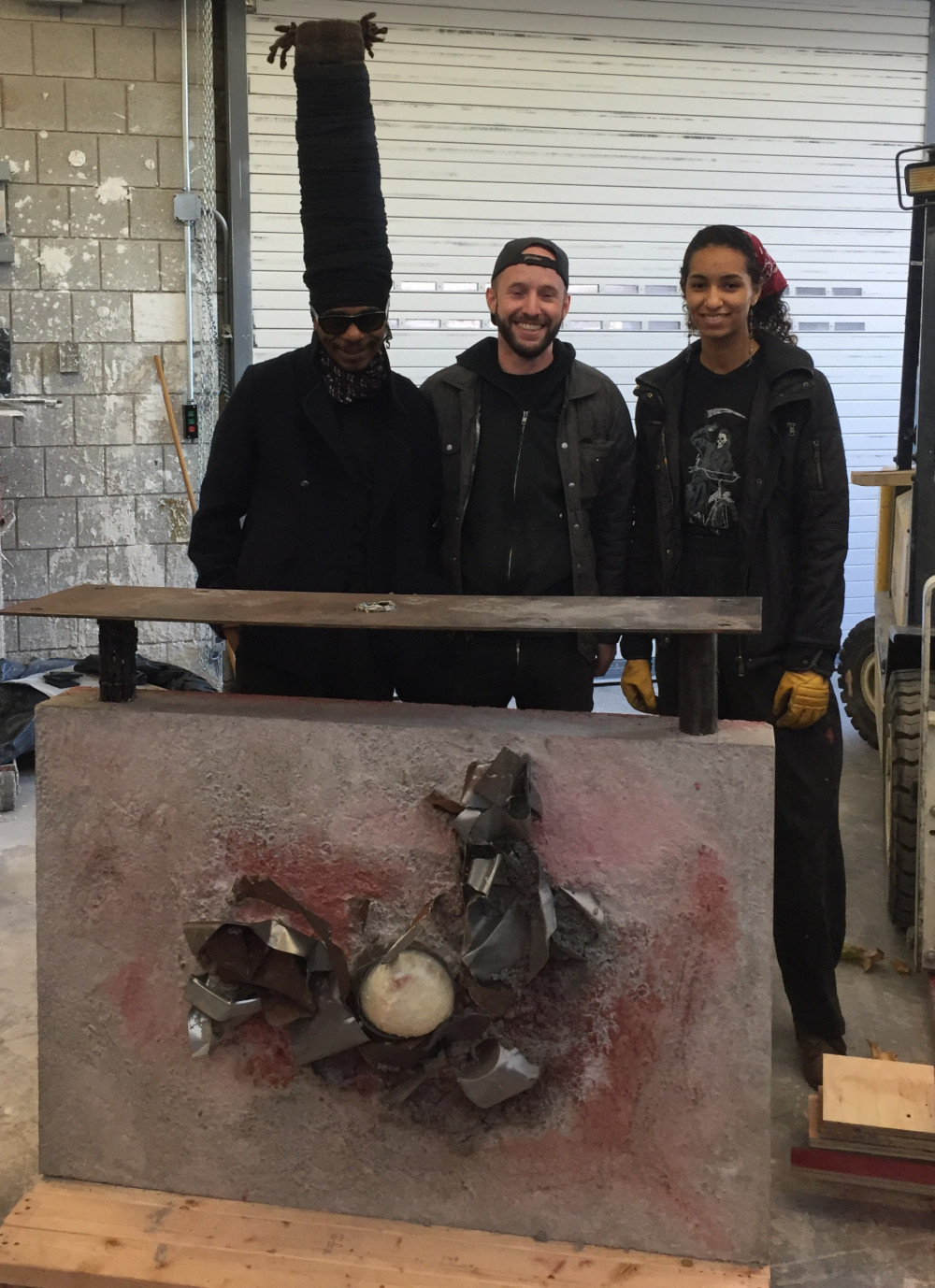 From Left to right: Engels the Artist; 3-D Media Instructor Felix Matta-Fletcher; and student Gabriella Rosen pose with the final work of art.
