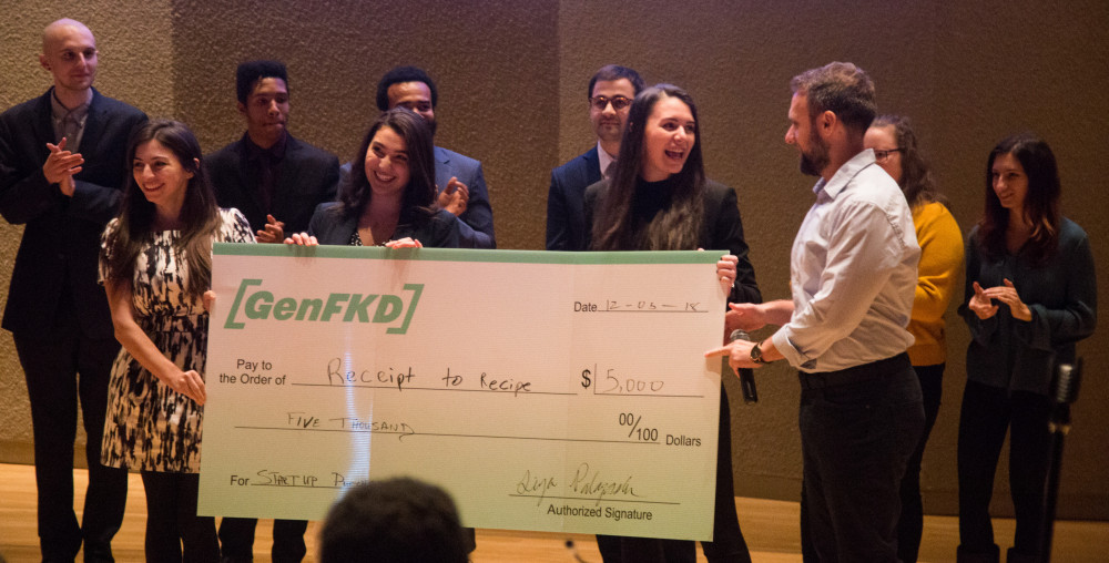 Seniors Angela Galli and Kelly Hayes receive oversized check for winning the second annual Start Up Purchase Pitching Competition
