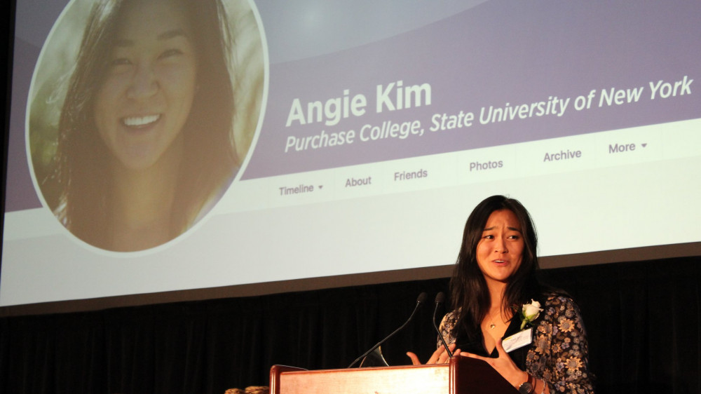 Angie Kim delivers remarks onstage at the 2018 Milli Awards