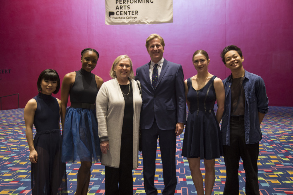 Student dancers on either side of Lucille Werlinich, Purchase College Foundation Board President and James Sandling, Chair of The Performing Arts Center Board of Trustees (left and right center)