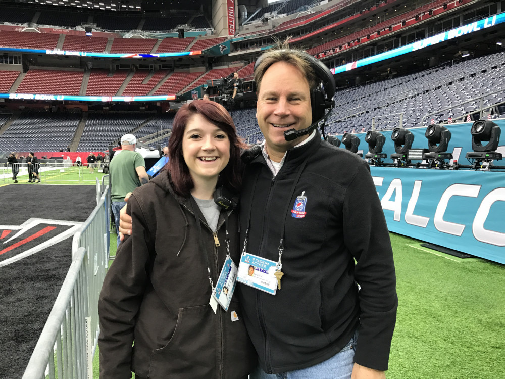 Design Tech student Megan Seibel with her professor Dave Grill at the Super Bowl