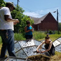 Students and collaborators work on American Riad project in Detroit