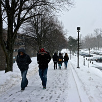 Students walk in the snow on campus.