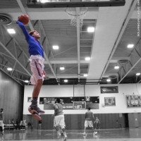 Max Pearce '18 slam dunks in the gym