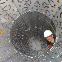 Director, School of Art+Design Christopher Robbins inside the sculpture on site at the American R...