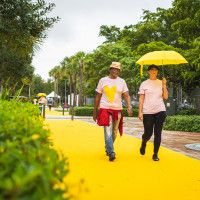 Participants walk on the The Yellow Walk performance created by Kate Gilmore