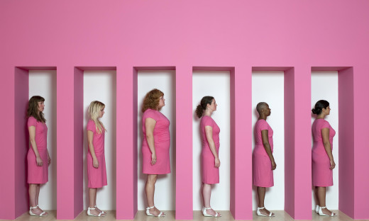 Kate Gilmore, Wall Bearer, 2011. Performance and installation at the Weatherspoon Art Museum, Greensboro, NC (Women in pin...