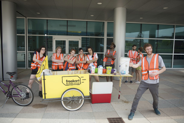 New Media Tactical Practical class hand out free refreshments from their freekart project.
