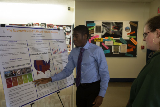 Student presenting his poster at the 37th Annual Symposium