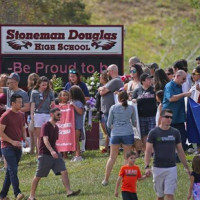 Parents and students returning to Marjory Stoneman Douglas High School in Parkland, Florida on February 25, weeks after th...