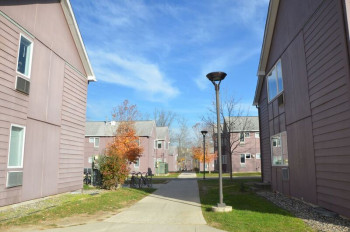 Exterior pathway and buildings of Alumni Village.