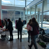 Students browsing clothing donations at Job Fair Prep Day.