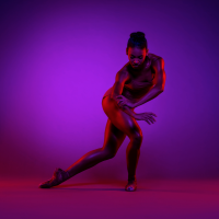Raven Barkley ?15 / Photo: Todd Rosenberg, Courtesy Charlotte Ballet (Barkley holds a dance pose ...