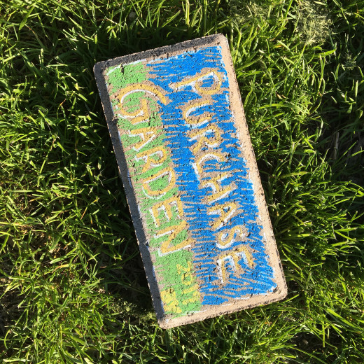 A painted brick left in the garden
