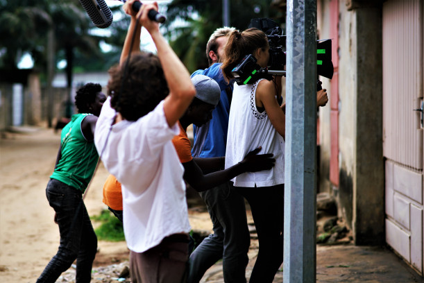 Co-director Chad Hilton and crew on the set of Livin' in the Rain (Cotonou, Benin)