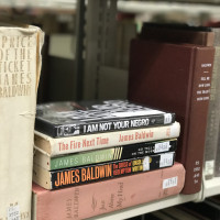 James Baldwin book stack