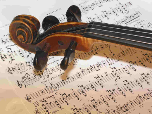 Image depicts violin over sheet music